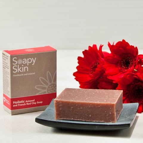 Soapy Skin natural handmade aniseed and red clay soap boxed and unboxed with red flowers