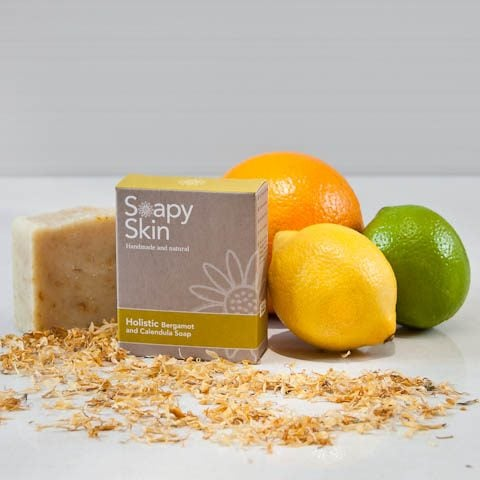 Soapy Skin natural handmade bergamot and calendula soap boxed and unboxed with citrus fruits and calendula petals