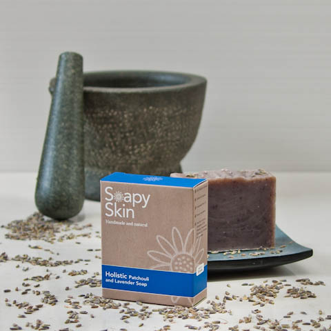 Soapy Skin natural handmade patchouli and Lavender soap boxed and unboxed with lavender buds