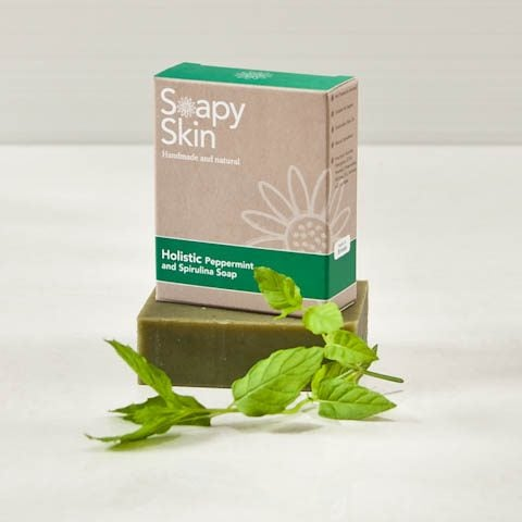 Soapy Skin Holistic Peppermint Soap boxed and unboxed with a sprig of mint