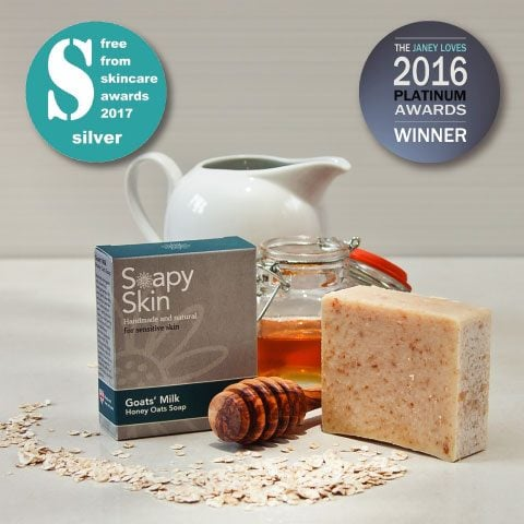 The FreeFrom Problem Skin Silver Award 2017 and the Janey Loves Platinum award winner 2016. Soapy Skin Goats Milk Soap - Honey Oats boxed and unboxed with a pot of honey, a milk jug and oats