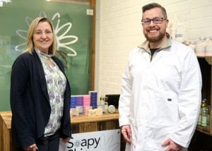 Janet and David, owners of Soapy Skin Ltd, stood in the factory shop.
