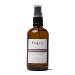 Dajan Organics grounding massage oil in an amber bottle