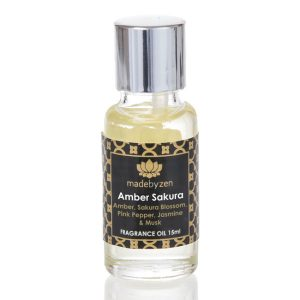 Amber Sakura Signature Fragrance Oil in clear bottle with silver cap