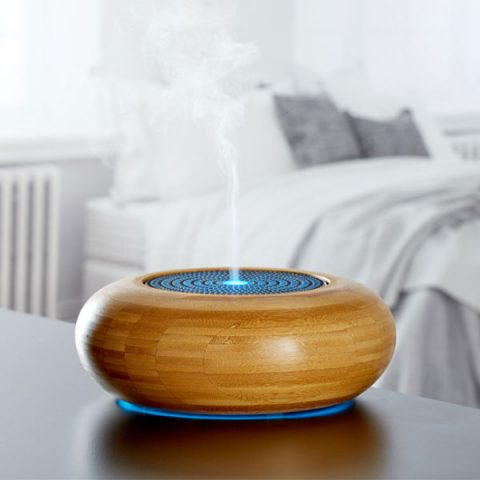 MadeByZen Arran Ultrasonic Diffuser in bamboo. Shown in the bedroom