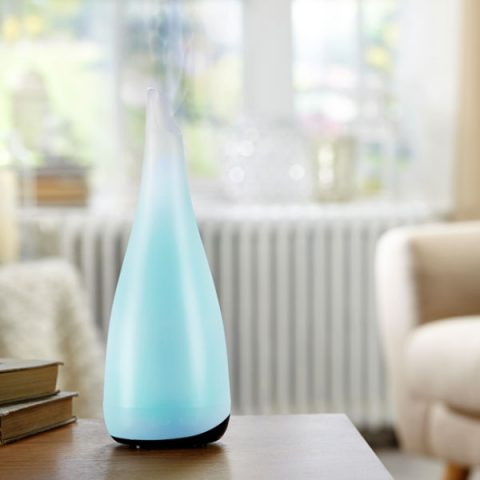 MadeByZen Kharis Ultrasonic Diffuser with blue light in living room